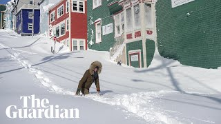 A massive winter blizzard that buried Newfoundland in snow and cut power to thousands of homes has prompted the government of the island's capital St John's to declare a state of emergency.