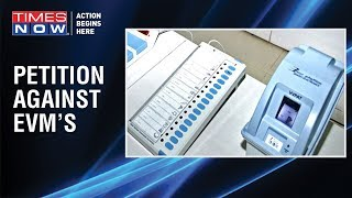 After jolting exit poll predictions, opposition to petition Election Commission over EVM's