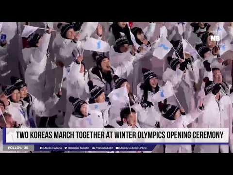 Two Koreas march together at Winter Olympics opening ceremony