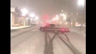 Car losing control in snow in Salt Lake City