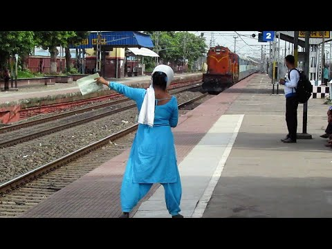 A lady gives cautionlist to the Loco pilot and Guard of a running train || Indian Railways