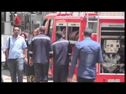 سيارات الإطفاء تحاول السيطرة علي حريق وزارة التموين