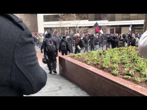 Inauguration Protesters Smash Starbucks Windows in DC