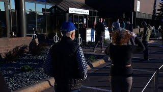 People line up in Minnesota as early voting begins