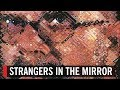 Strangers in the Mirror