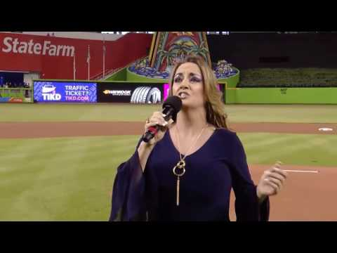 Student, Caroline Biggs, sings for the Marlins Baseball Team