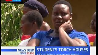 Students torch two houses of a family they claimed bewitched their colleague