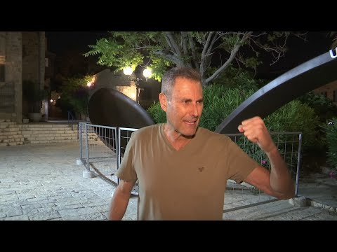 Uri Geller, the illusionist known for his spoon-bending stunts, unveils an 11 ton spoon in Jaffa, Tel Aviv, next to the site where he plans to open his museum next year. (May 23)