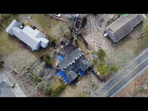 Drone footage of the Couto Construction team hard at work installing Rustic Black Tamko shingles in South Yarmouth, MA.