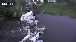 Freight train plummeted into Floyd river after bridge collapse in Iowa