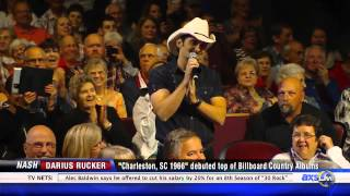 Brad Paisley invites Darius Rucker to join Grand Ole Opry