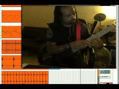 "Working in the studio on a ""Rock Meets Trap"" style hip hop beat using a Midi guitar to trigger notes in Reason."