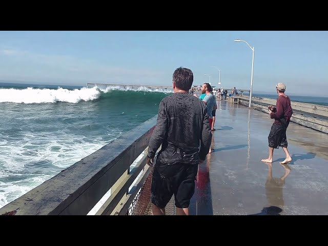 Big wave wets tourist funny