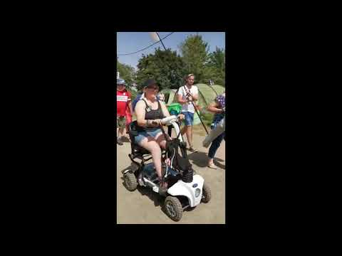 Ideal mobility scooter for festivals - Natalie with her Maximo at Glastonbury 2019 YouTube video thumbnail
