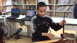 Blind student playing instrument for us Vietnam