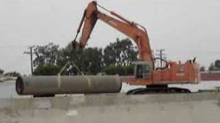 Hitachi EX1100 massive pipe lift