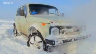 """ВАЗ 2121 """"Нива""""1986 года выпуска в свежевыпавшем снегу."""