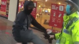 video: Armed robber on the run attacks police after being stopped on the way to buy video game
