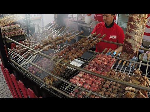 Italy Street Food. Pig Knuckles, Lamb, Pork Skewers, Melted Cheese