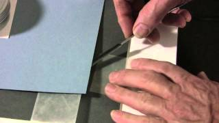 Attaching artwork with a v-hinge to backing board