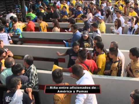 Violencia entre aficionados de América y Pumas en los alrededores del Estadio Azteca