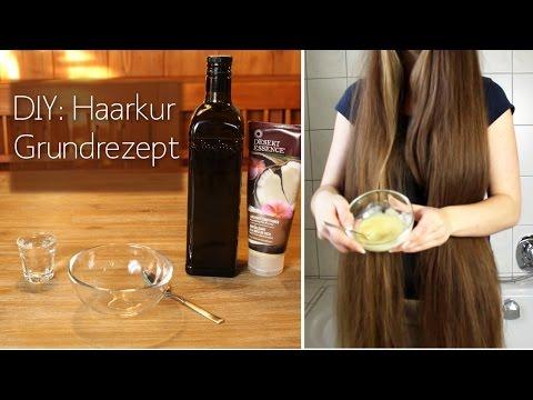 Die Anwendung des Öls kletten- für das Haar