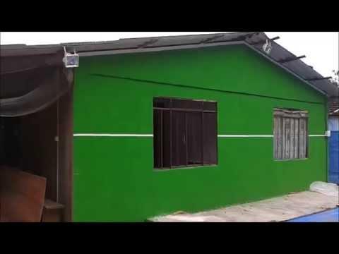 Casa de madeira com grafiato