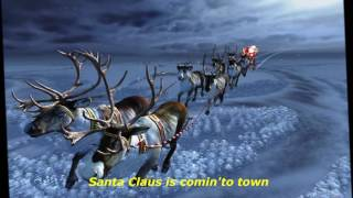 Santaclaus is comin'to town, singing by Burl Ives