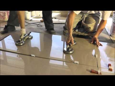 Porcelain tiles 2'x4′ (24″x48″) installation – Polmaster's New Showroom