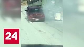 В США многотонный грузовик протащил за собой легковушку с людьми
