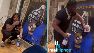 """Rowdy Rebel cleans off his certified gold plaque 💿 for """"computers"""" featuring Bobby Shmurda"""