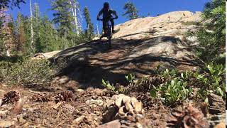 Riding a fun slab feature along Gold Valley Rim Trail.