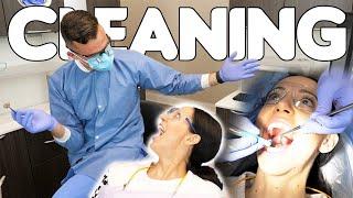 Dentist Cleans Dental Hygienists Teeth