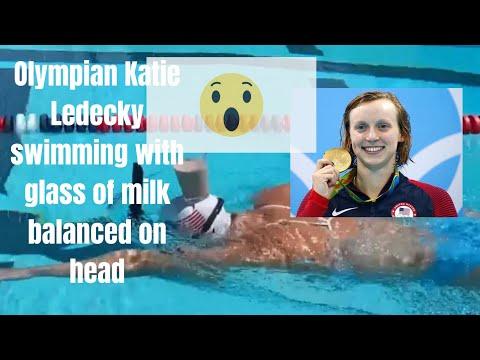 Olympian Katie Ledecky swimming with glass of milk balanced on head