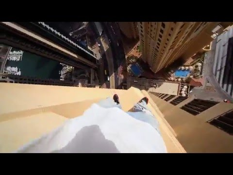Daring Parkour Runner Jumping Along Edge Of Skyscraper Will Make Your Palms Sweaty
