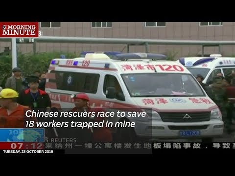 Chinese rescuers race to save 18 workers trapped in mine