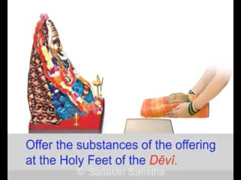 The appropriate method of offering a sari to devi