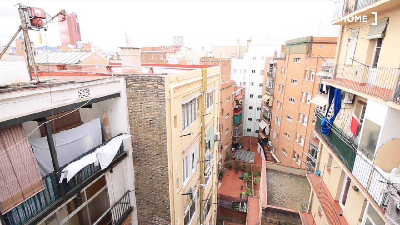 Furnished room with window view interior patio in shared apartment, Sants
