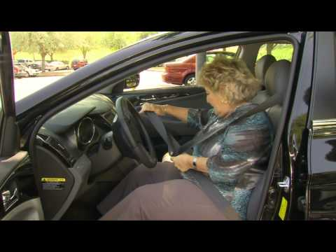 Elderly lady getting in vehicle and putting on on her seatbelt