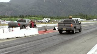 Drag Racers racing their tow vehicles in the rain