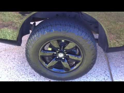 "2010 Nissan Titan black powder coated OEM 18"" wheels"