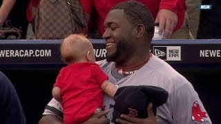 Big Papi holds young fan during national anthem