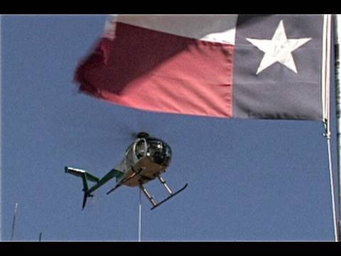 Video: Nutters Fixing High Voltage Lines From Helicopters