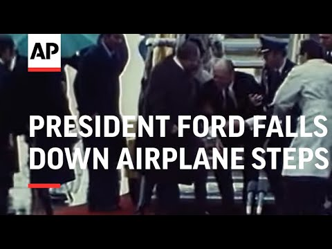President Ford falls down airplane steps