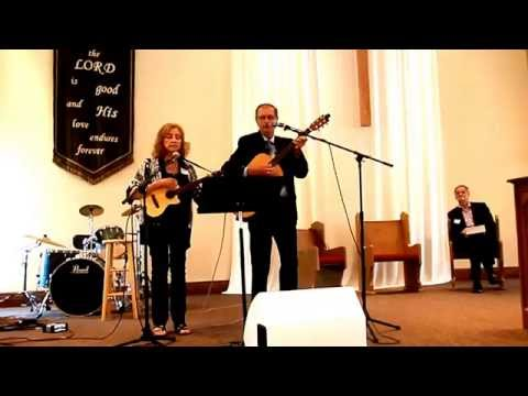 """2016 - Awna and Colleen singing """" There is a Garden"""", a tribute at the funeral of Mom de Haan.  Rev Shadde looking on."""