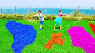 Sihirli su Ali and Adriana play with magic water colored grass for kids video