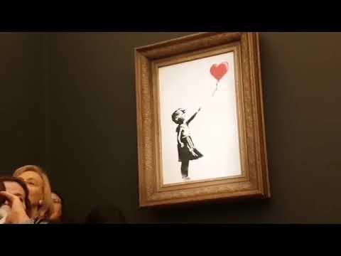 Banksy'nin 'Balonlu Kız' tablosu kendi kendini imha etti