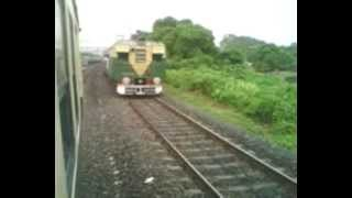 preview picture of video 'Barddhaman Sealdah Local Passes Naihati-Bandel Local Near Bandel Station.mpg'