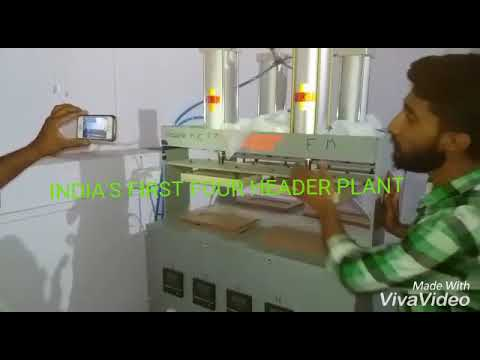 Four Header Sanitary Pad Making Machine