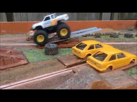 Scale Model Slot Monster Trucks Racing and Freestyle on Scratch Built Scalextric Track.
